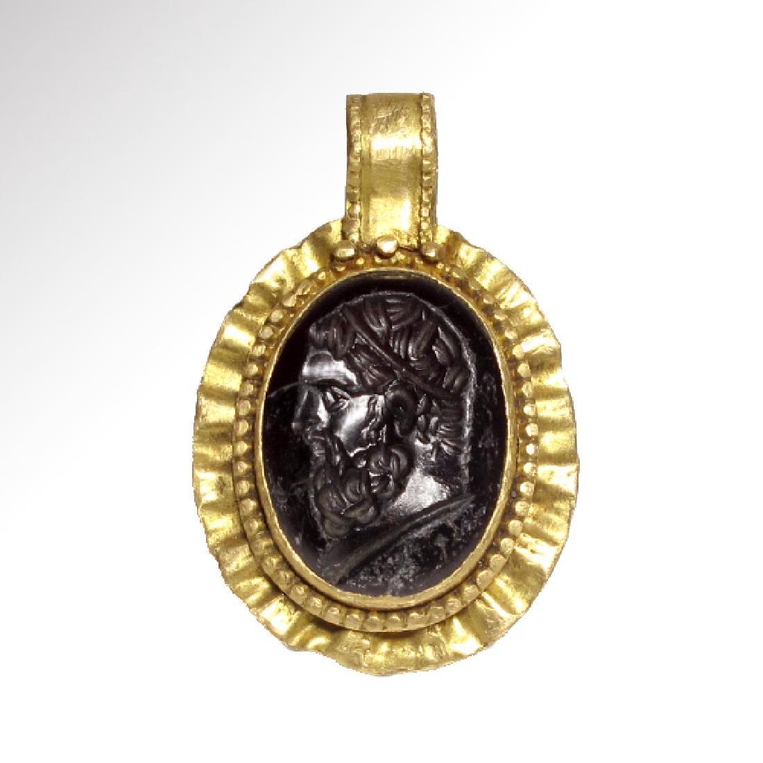 Roman Garnet Intaglio with Bust of Zeus/Jupiter in Gold