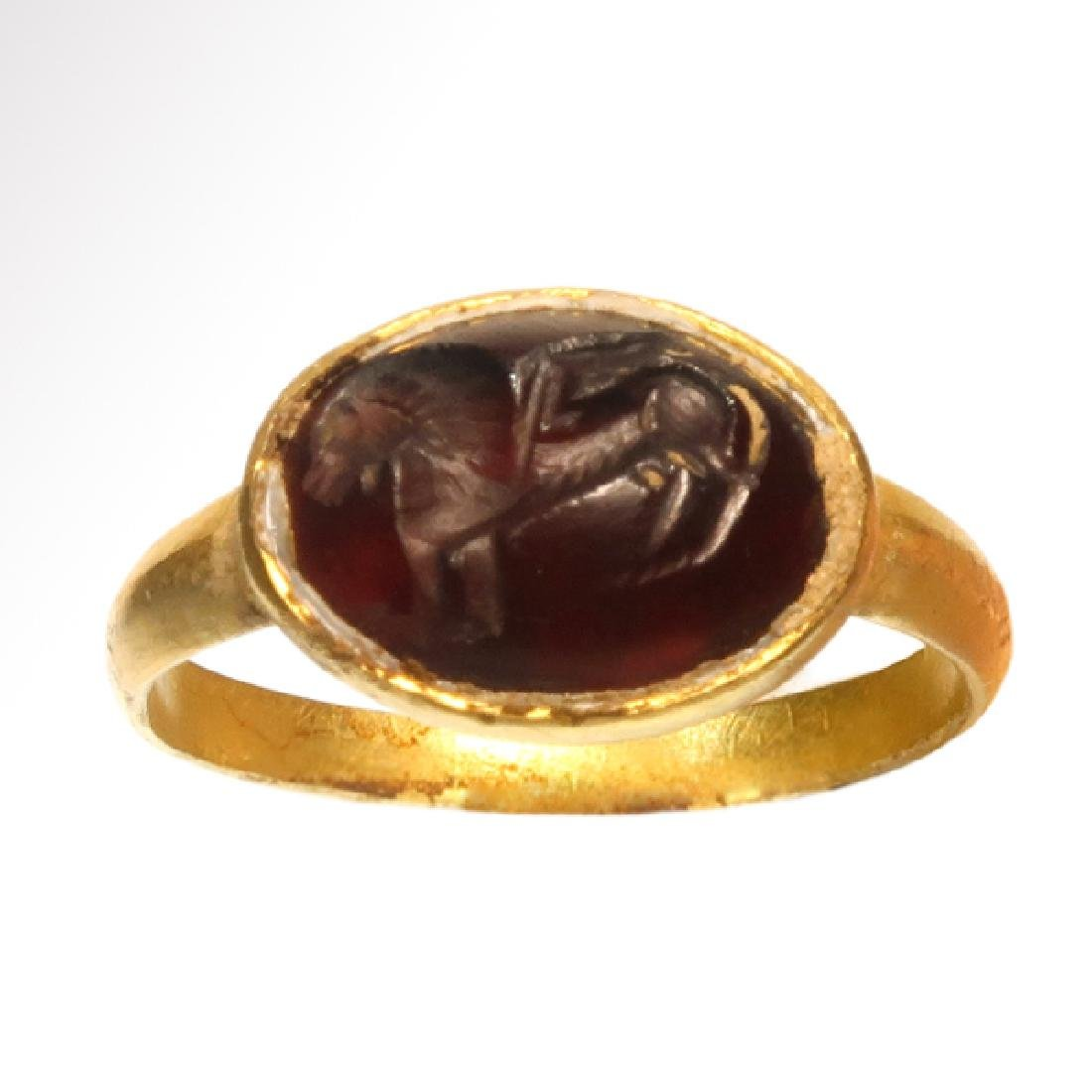 Roman Gold Ring with Garnet Intaglio with Winged Lion
