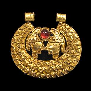 Medieval Gold and Garnet Pendant with Birds, Migration