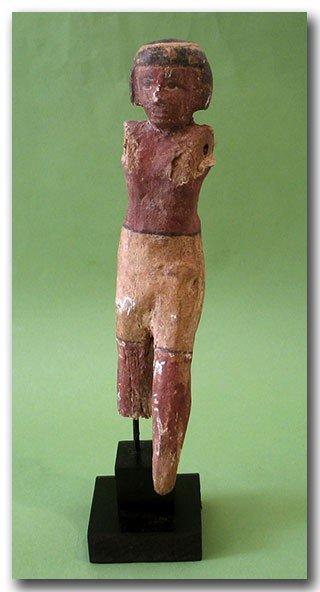 13: Egyptian Wooden Figure, c. 2000 B.C.