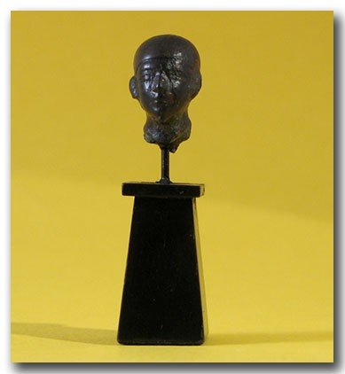 15: Egyptian Bronze Head Priest , c . 900 B.C.