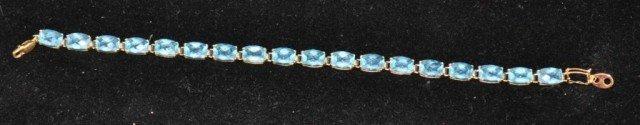 14: Stamped 14kt Faceted Blue Stone Bracelet