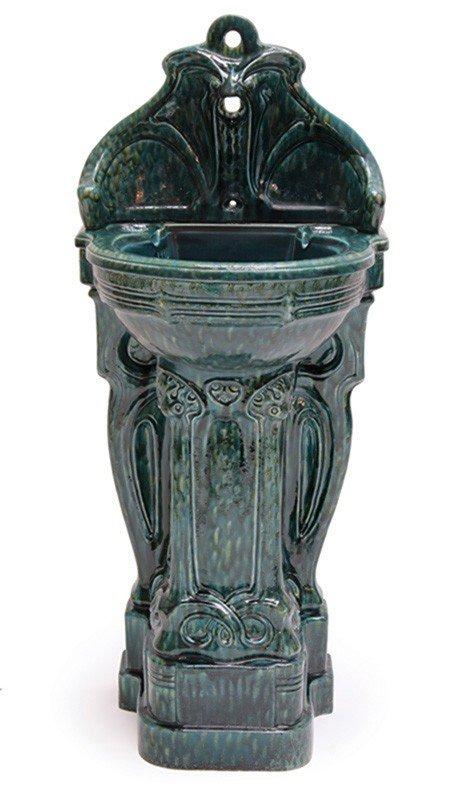 6: Wandbrunnen
