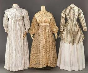 THREE LADIES' COTTON PRINT GARMENTS, 1860-1890