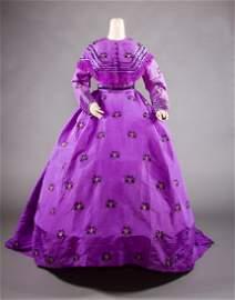 TRAINED PURPLE BROCADE VISITING DRESS, c. 1865