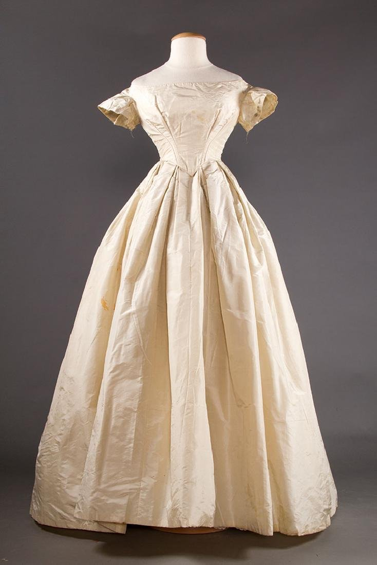 WHITE SILK WEDDING GOWN, EARLY 1850s