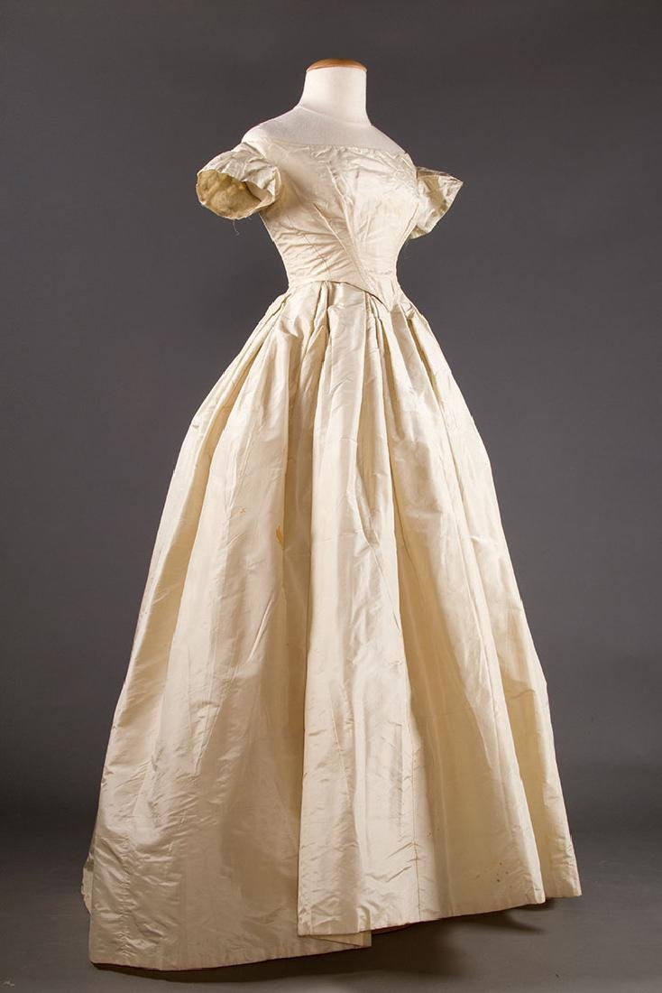 WHITE SILK WEDDING GOWN, EARLY 1850s - 2