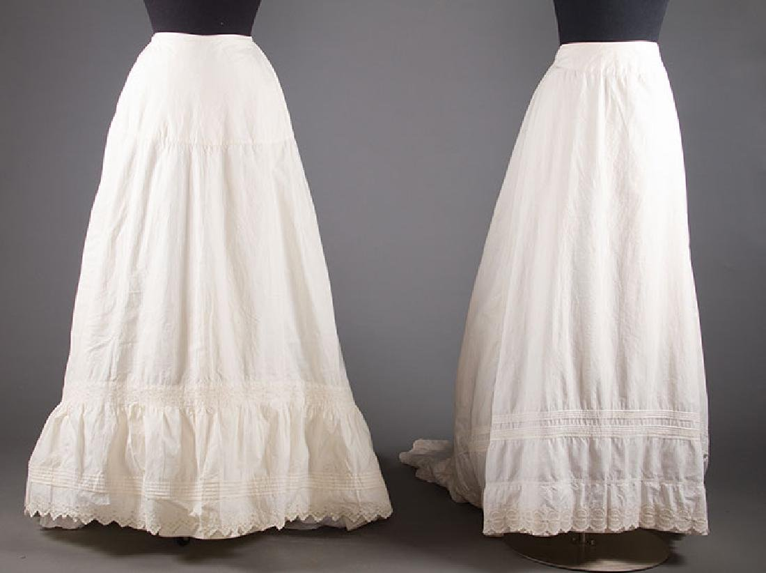 TWO TRAINED BUSTLE PETTICOATS, 1870-1880s
