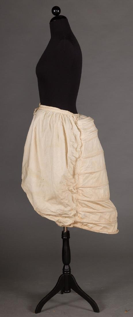 LOBSTER TAIL BUSTLE, 1870-1880