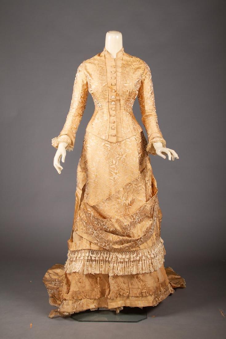 GOLD BROCADE BUSTLE DRESS, 1870s