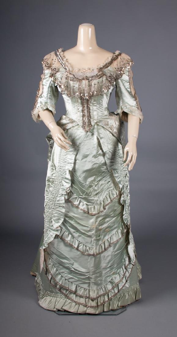 SEQUINNED BLUE SILK EVENING GOWN, 1870s