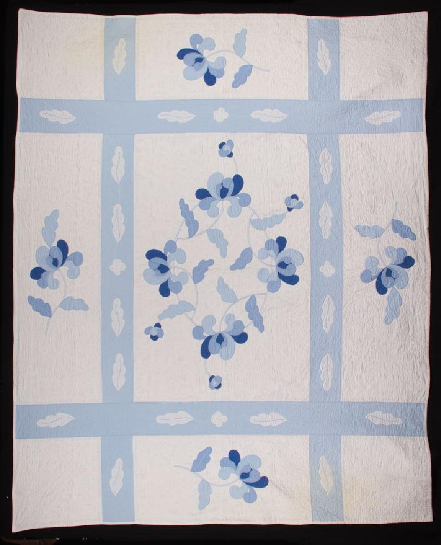 PAIR OF BLUE ON WHITE APPLIQUE QUILTS, 1930-1940s