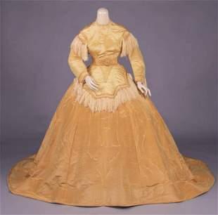 GOLDEN SILK MOIRÉ GOWN, c. 1867-1868