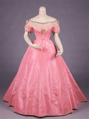 PINK SILK TAFFETA EVENING GOWN, 1868-1870