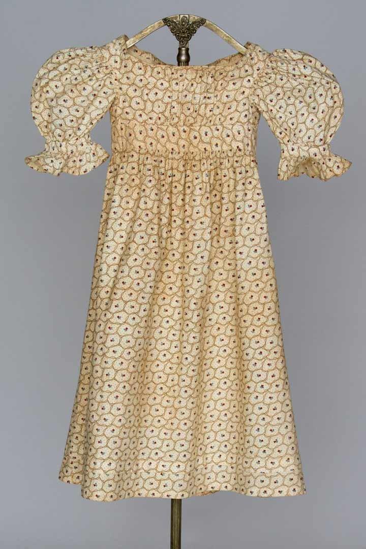 CHILD'S COTTON CALICO DRESS, 1820s