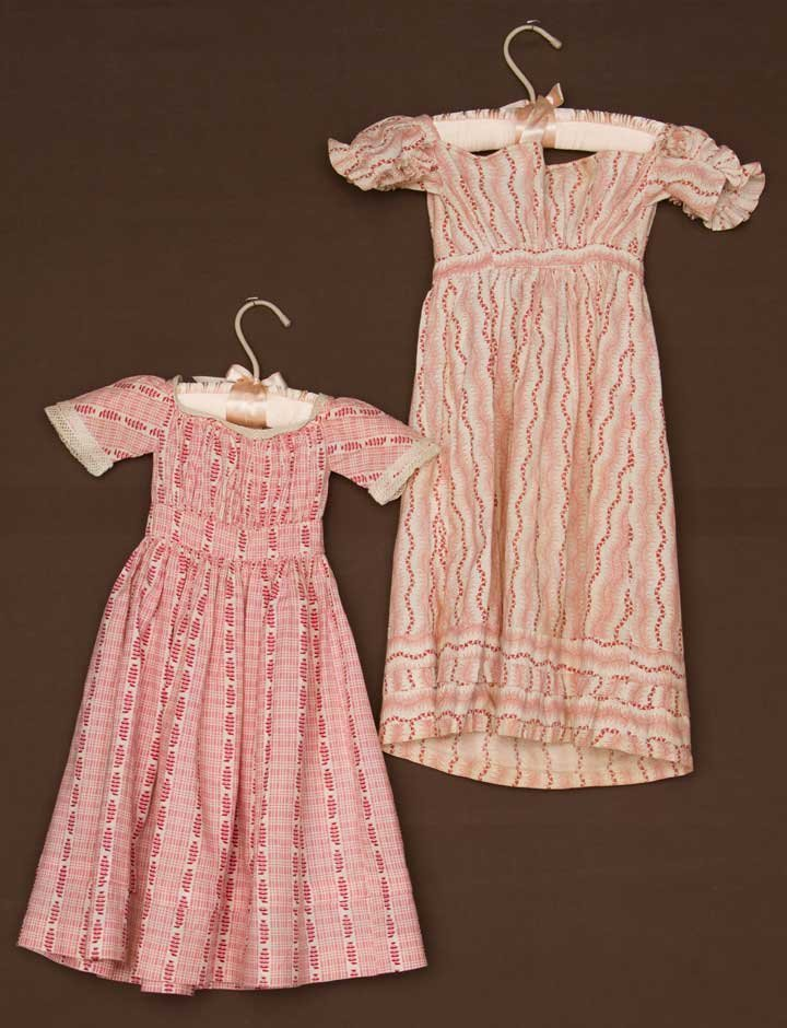 TWO PINK TODDLERS' DRESSES, 1820-1840