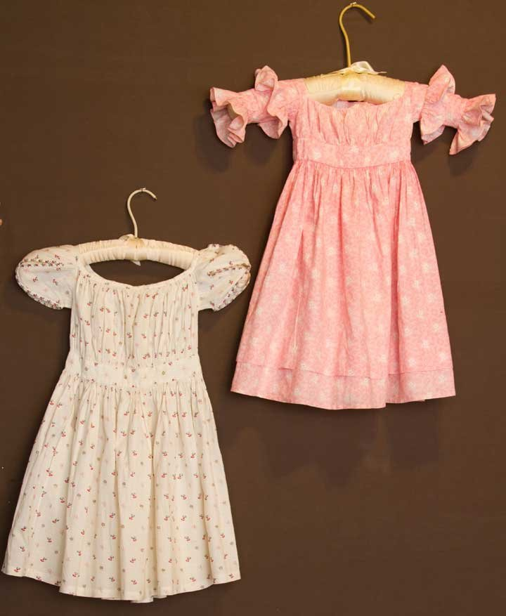 TWO TODDLERS' CALICO DRESSES, 1830-1840
