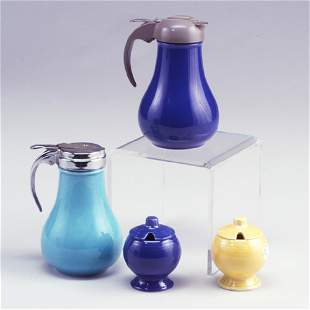 4 FIESTA pieces: two syrup pitchers with D