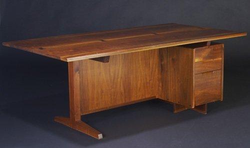 22: GEORGE NAKASHIMA Walnut three-drawer desk with four