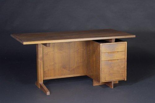 23: GEORGE NAKASHIMA Walnut three-drawer desk with gril