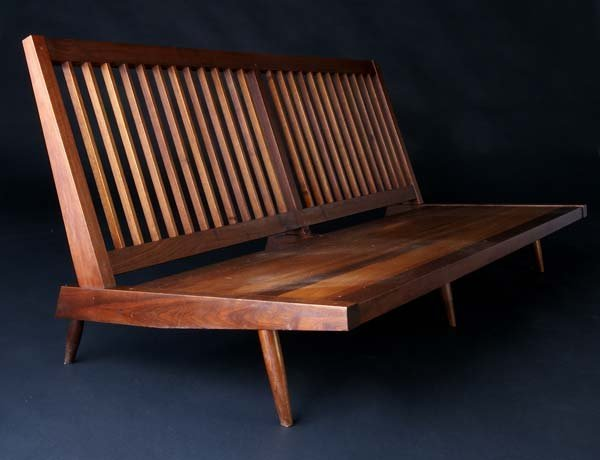 16: GEORGE NAKASHIMA Walnut armless settee. (Provenance