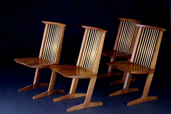 18: GEORGE NAKASHIMA Four walnut Conoid chairs. (Proven