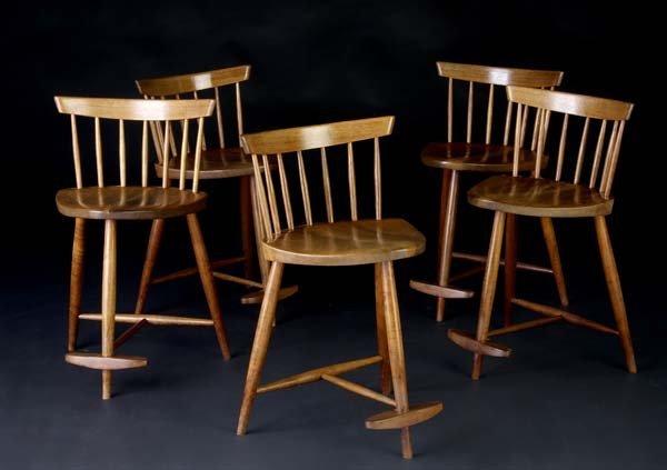 23: GEORGE NAKASHIMA Five walnut Mira stools. (Provenan