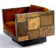245: PAUL EVANS Copper patchwork swivel cube chair upho