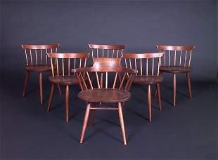 "GEORGE NAKASHIMA Five walnut ""Mira"" chairs and a Ca"