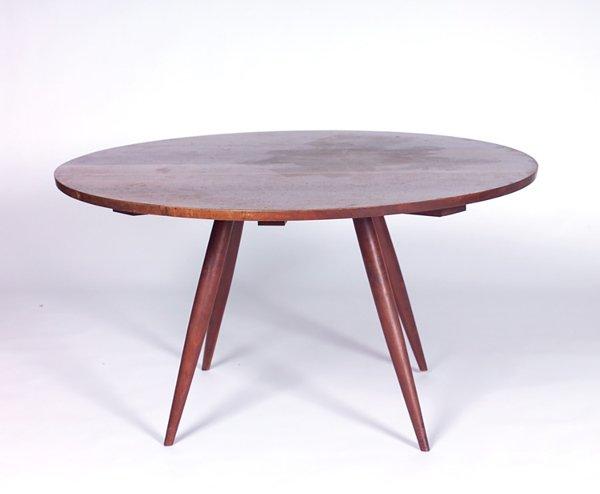 22: GEORGE NAKASHIMA Walnut dining table with circular