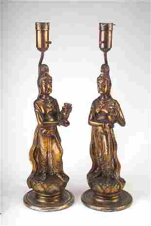 JAMES MONT Pair of carved wood lamp bases depicting