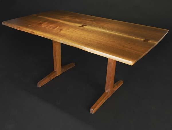 4: GEORGE NAKASHIMA Walnut Trestle table, its top with