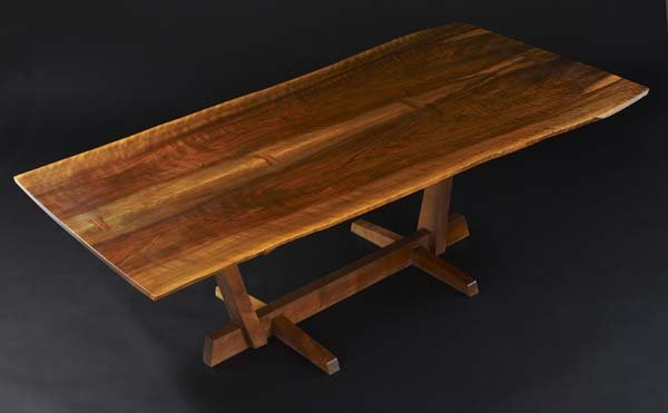 11: GEORGE NAKASHIMA Conoid dining table with bookmatch