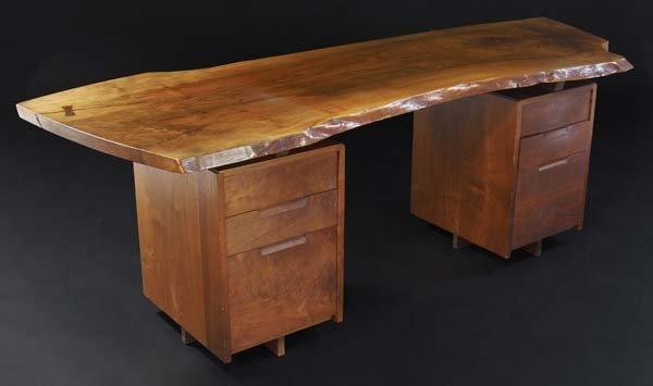 13: GEORGE NAKASHIMA Double-pedestal desk in walnut, it