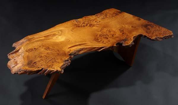 17: GEORGE NAKASHIMA Slab coffee table in walnut with f