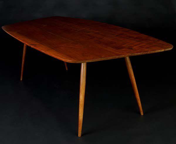 PHILLIP LLOYD POWELL Walnut dining table with turn