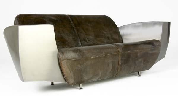 720: JONATHAN SINGLETON Stainless steel sofa with aged