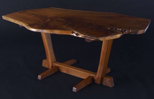 13: GEORGE NAKASHIMA Walnut Conoid dining table, its fr