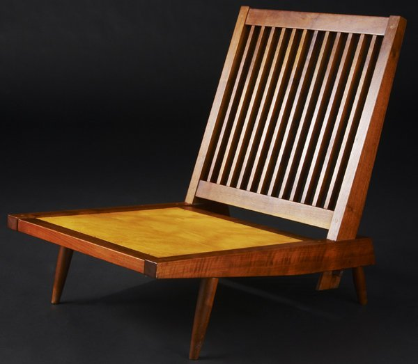 23: GEORGE NAKASHIMA Walnut Cushion chair. Marked with