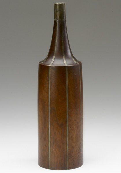 121: PAUL EVANS / PHILLIP LLOYD POWELL Walnut bottle wi