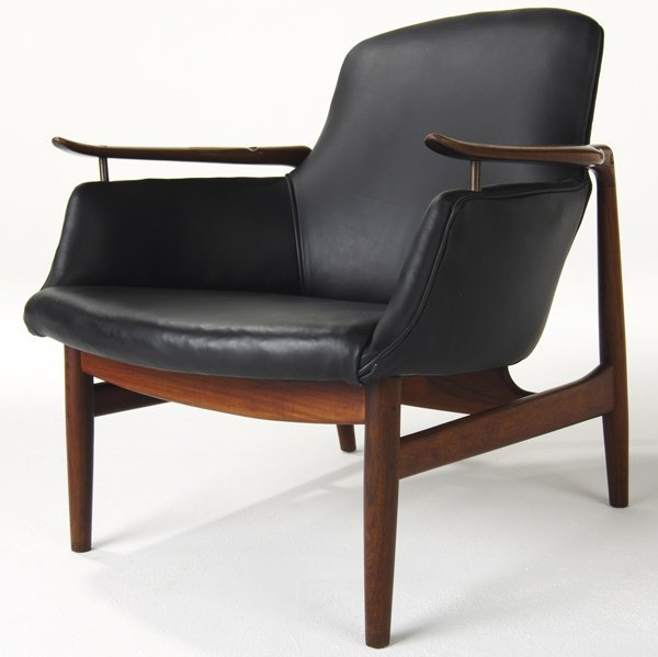609: FINN JUHL No. 53 Easy chair on sculpted rosewood f