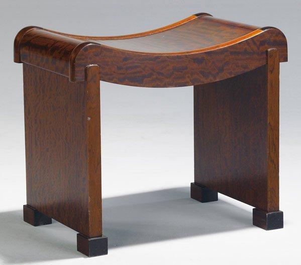 601: PIERRE CHAREAU Mahogany stool, en suite with desk.