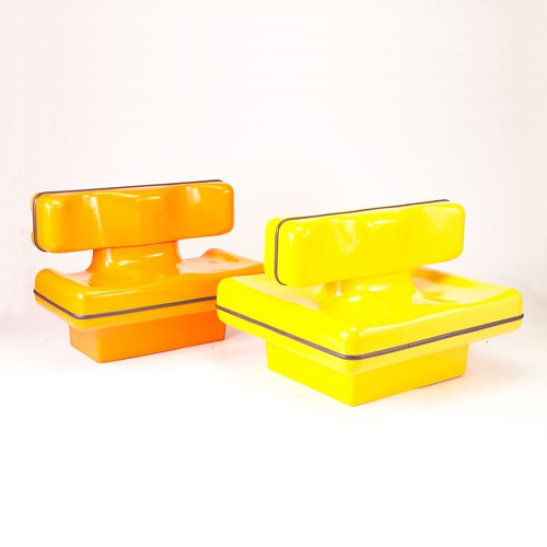 371: La Defense pair of French cast fiberglass settees,