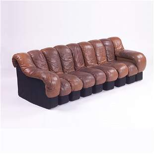 Stendig Nonstop sofa of chocolate brown leather, l