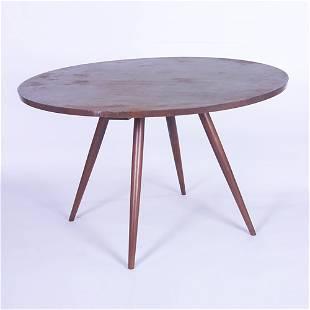 GEORGE NAKASHIMA Walnut dining table with circular