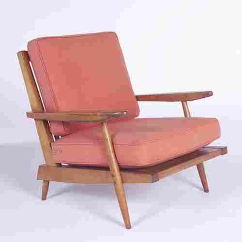 GEORGE NAKASHIMA Armchair with slatted back and sa