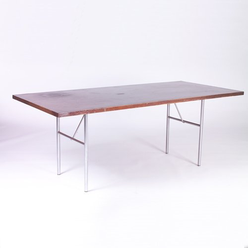 821: HERMAN MILLER Dining table with rectangular walnut
