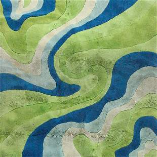 EDWARD FIELDS Area rug with a swirl pattern. Mark