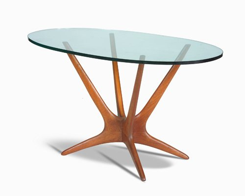24: VLADIMIR KAGAN Occasional table with oval plate gla