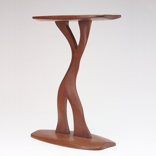 1012: ROBERT WHITLEY Carved walnut accent table with fr